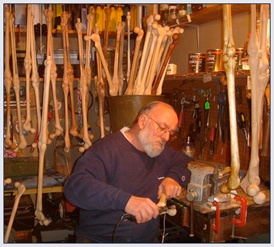 Bob hand craving a beautiful leg bone collectable cane.